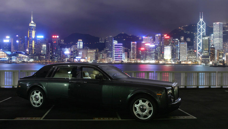 Hong Kong: The former British colony has the highest concentration of Rolls-Royces of  any city in the world. But it is also home to one of the world's most notorious  slums, where 100,000 people live in units smaller than 60 square feet,  including cages and cubicles. Above, an extended-wheelbase Rolls-Royce Phantom awaits, as the glittering skyline of Hong Kong shines in the background.
