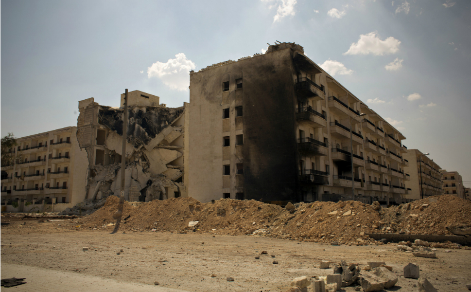 Bombed-out buildings  at an intersection in Aleppo on Aug. 8.