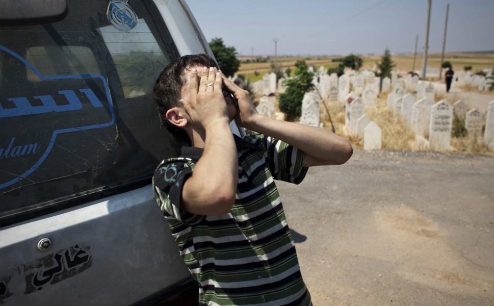 A young boy cries  for Abdul Rahman at his funeral in Tal Rifaat on Aug. 9.