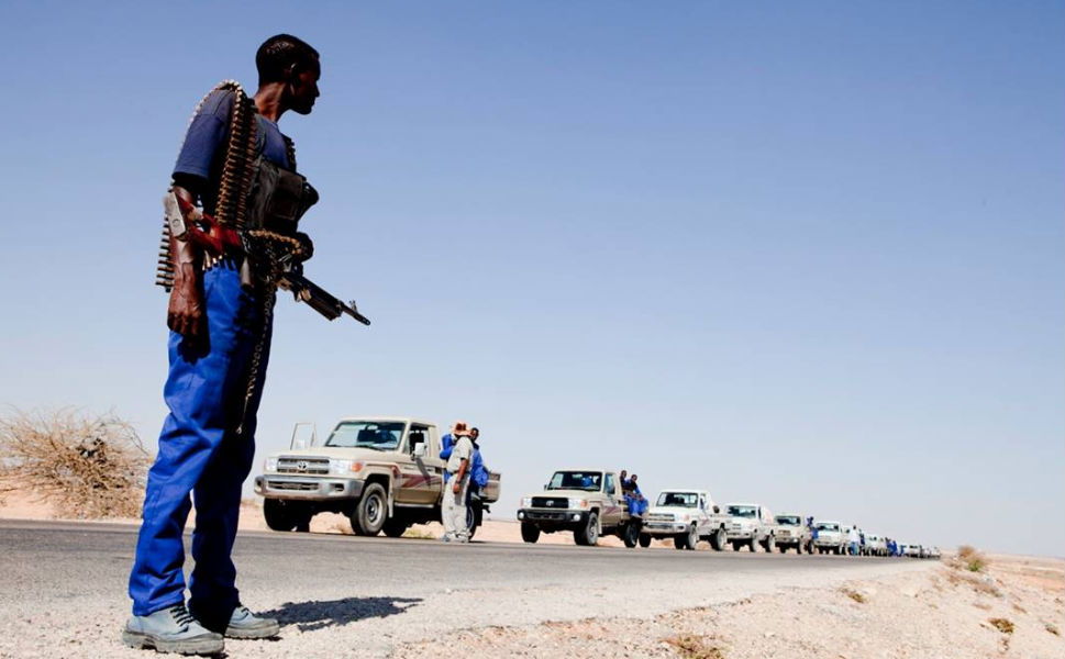In addition to anti-piracy work, the PMPF took on other roles. Here, a convoy of the recruits deliver water with Western mentors during Somalia's 2011 drought.