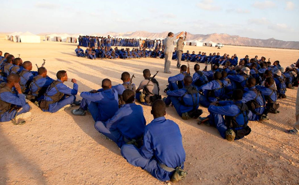 A South African trainer and interpreter provides evening briefings   before prayer to the Somali recruits for the PMPF in Bosaso in 2011. Two groups of   450 men each were trained to conduct anti-piracy police work.