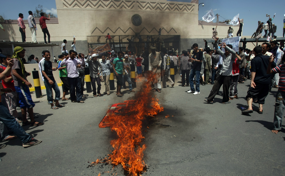 Yemeni protesters gather around a fire during a demonstration over the film outside the   U.S. embassy in Sanaa on Sept. 13.