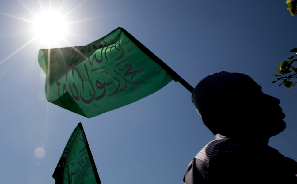 """Above, Arab-Israeli Muslim protesters raise green Islamic flags with the Muslim  profession of belief: """"There is no God but God and Mohammed is the   prophet of God"""" during a protest against the film in front of the U.S. embassy in Tel Aviv, Israel, on Sept. 13."""