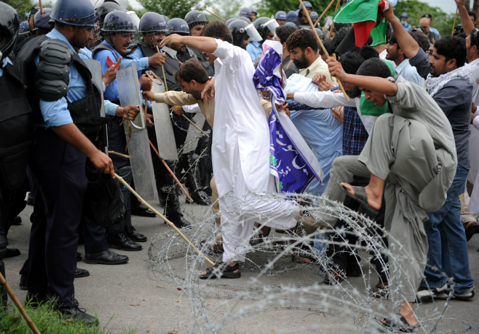 Pakistani Muslim protesters cross barbed wires as they attempt to reach   the U.S. embassy during a demonstration on Sept. 14.   Hundreds of Pakistani Islamists held protest rallies to denounce the   film, calling on the government to expel the U.S. ambassador and other   U.S. diplomats from Pakistan.