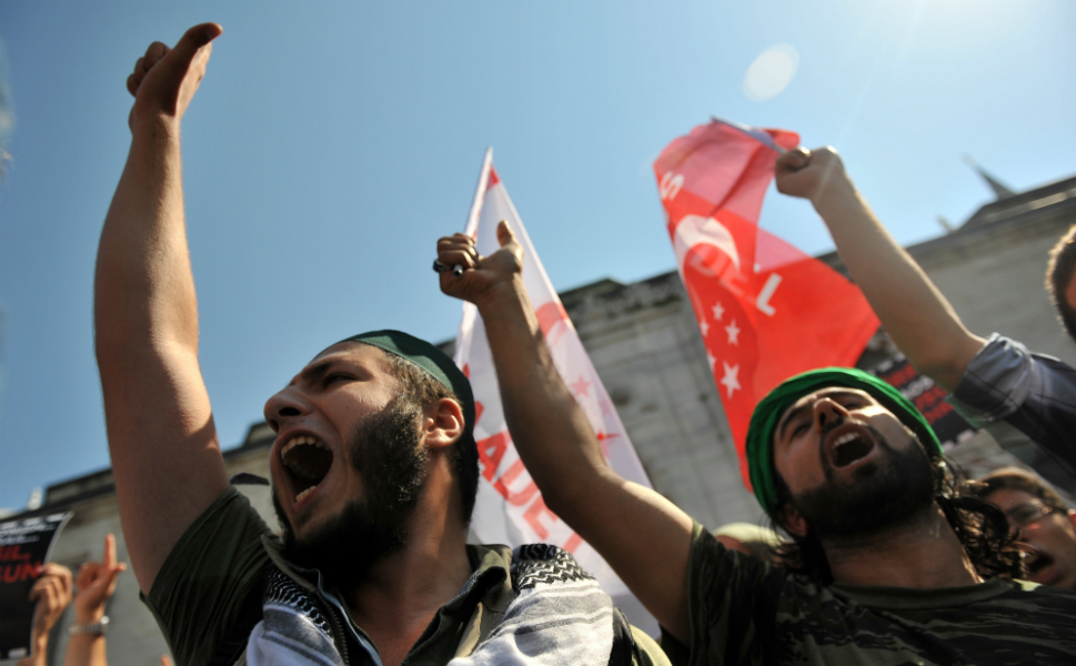 Turks chant anti-U.S. slogans during a demonstration against the film at  Beyazit Square in Istanbul on Sept.14. The film that sparked protests   across the Islamic world is a provocation against Muslims but should not  be used as a pretext for violence, Turkish Prime Minister Recep Tayyip   Erdogan said Friday.