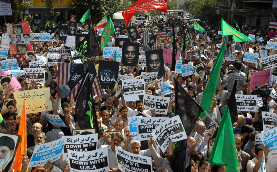 Iranian protestors hold anti-U.S. posters as they demonstrate after Friday prayers in Tehran on Sept. 14.