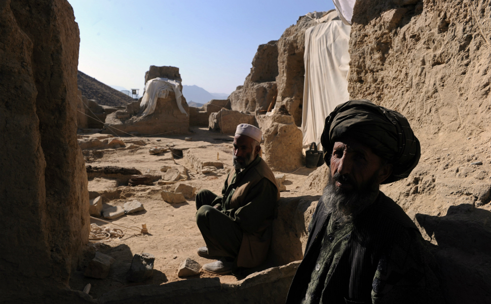 Afghans workers take a break from excavating an ancient   monastery in Mes Aynak on   Nov. 23, 2010.