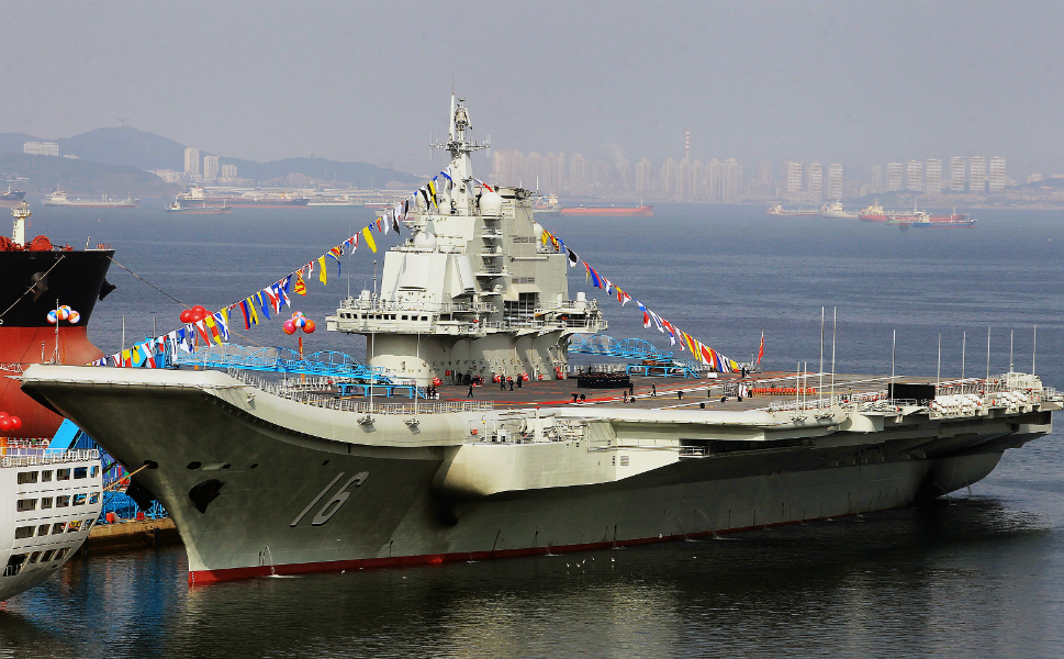 The Liaoning on Sept. 25, festooned with flags for its commissioning  ceremony.