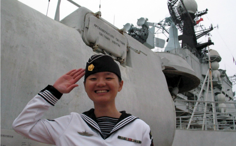 The former-Soviet aircraft carrier Minsk was converted into a museum --  Minsk World -- moored in Shenzhen, China. Above, a Minsk World guide greets  visitors in a Soviet naval costume in March 2004.