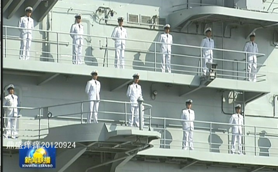 Chinese sailors in the PLA Navy stand  at attention during the commissioning ceremony for the Liaoning on Sept. 25.
