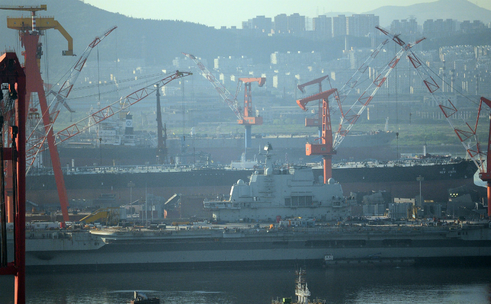The Liaoning née Varyag has  spent a decade docked at the Dalian shipyards in China's Liaoning Province, the  carrier's namesake. China's aircraft carrier program was approved in 2004,  after which the process of overhauling the ship began. Above, Chinese crews  work on reconstructing the carrier in July 2011.