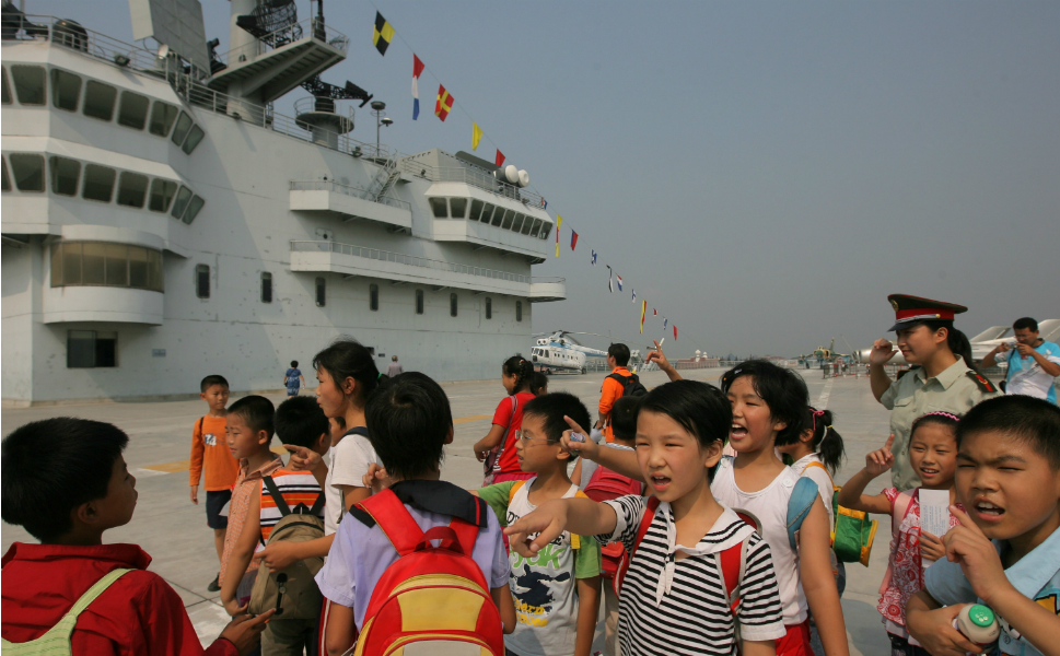 Chinese children visit the Military  Education Center exhibition space in September 2007. Instead of a former Soviet  ship, the center is a 7/8 scale replica of the U.S.S. Nimitz aircraft carrier. Located on  Dianshan Lake, China, near Shanghai, the museum opened in 2002.