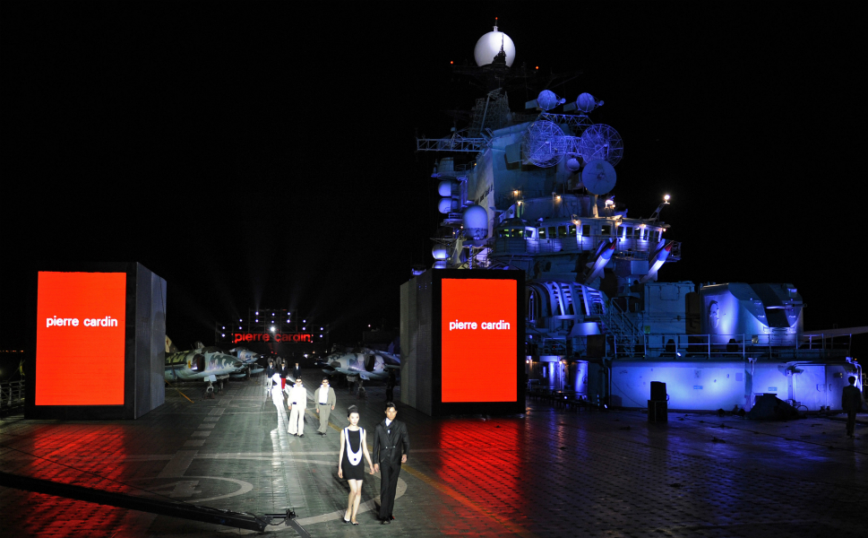 When not hosting its annual dance  party, the flight deck of the Binhai Aircraft Carrier Theme Park is used for  other trendy events. Here models in a fashion show strut down a different kind  of runway in May 2011. The centerpiece of the theme park is the retired Soviet  aircraft carrier Kiev, purchased by  China in 1996.