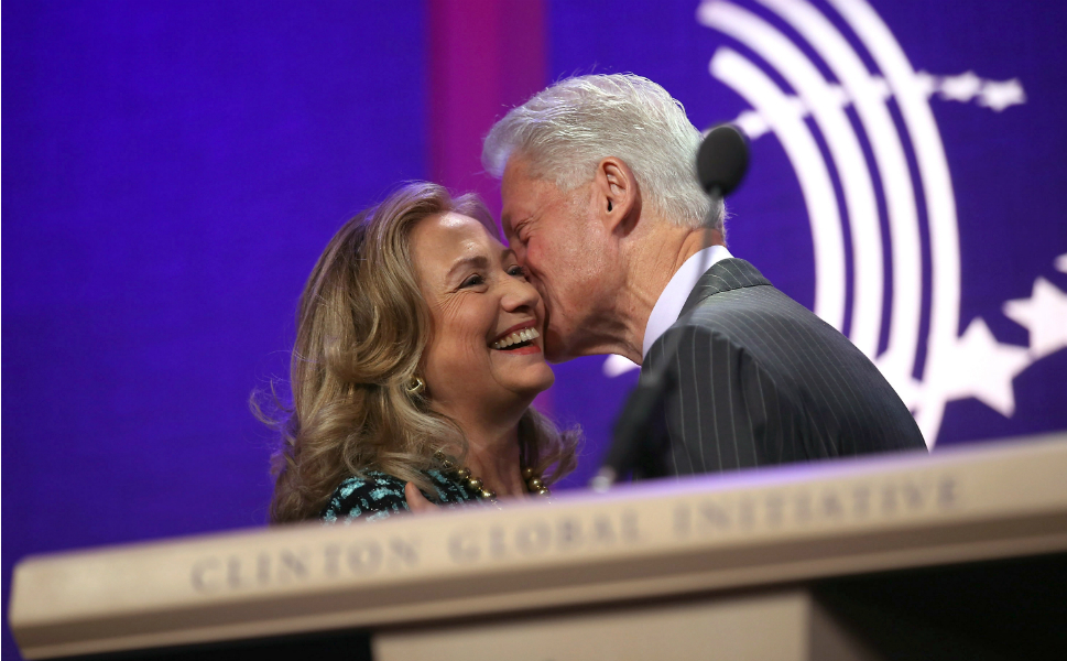 On Monday, the day before the speeches began at the United  Nations, Clinton started her morning speaking at the meeting of the Clinton  Global Initiative in New York. Here she is greeted by her husband, former President Bill Clinton, after he delivered an introduction to her remarks.