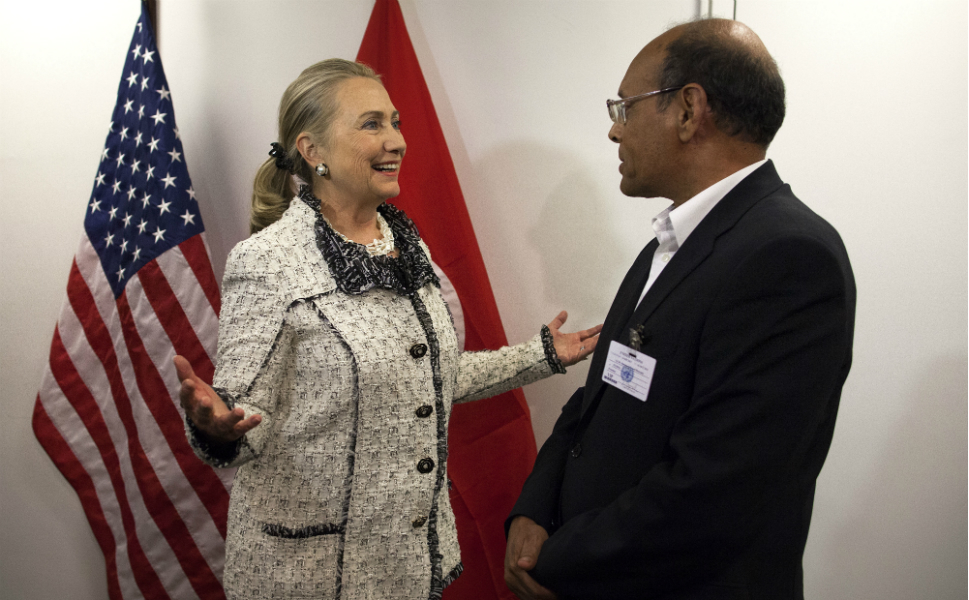 On Wednesday, Clinton met with Moncef Marzouki, the new president  of Tunisia. By the time this picture was taken, she had already delivered two  speeches and met with the king of Jordan and the foreign minister of Turkey.