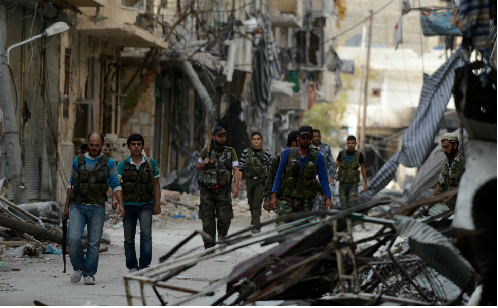 Syrian rebel fighters  walk during a break in the fighting.
