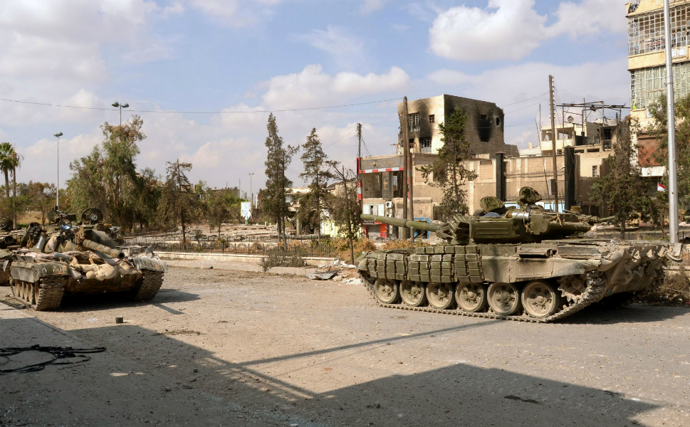 A unit of the Syrian  armed forces carry out a military operation in the Karm al-Gabal neighborhood of  Aleppo.