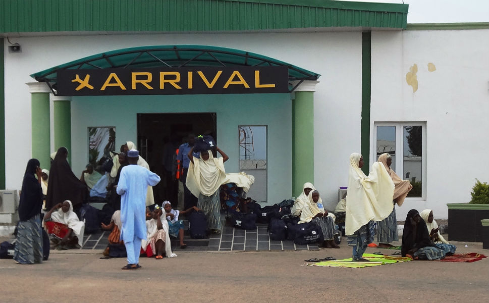 Nigerian hajj pilgrims wait outside the  arrival hall of Mallam Aminu Kano International Airport shortly after their  arrival in Medina on Sept. 26. This year, Saudi Arabia denied entry to some  1,000 Nigerian woman because they were not accompanied by men, leaving many  stranded at the Jeddah airport. About 171 of the women returned home to Nigeria on  a flight the same day.