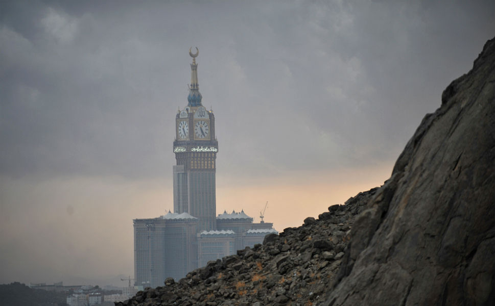 "The Abraj al-Bait towers, also known as  the Mecca Royal Hotel Clock Tower, seen from Jabal al-Noor, or the ""Mountain of  Light,"" which overlooks  Mecca, on Oct. 21."