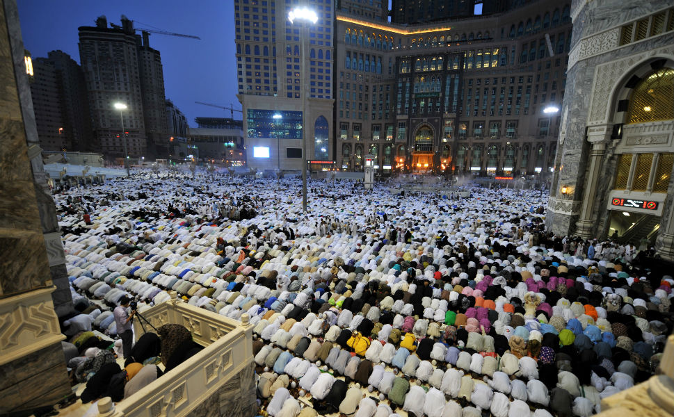 Above, Muslim pilgrims perform their  prayers in the Grand Mosque on Oct. 22. Over two  million Muslims from around the world are predicted to flood the Saudi city  of Mecca.