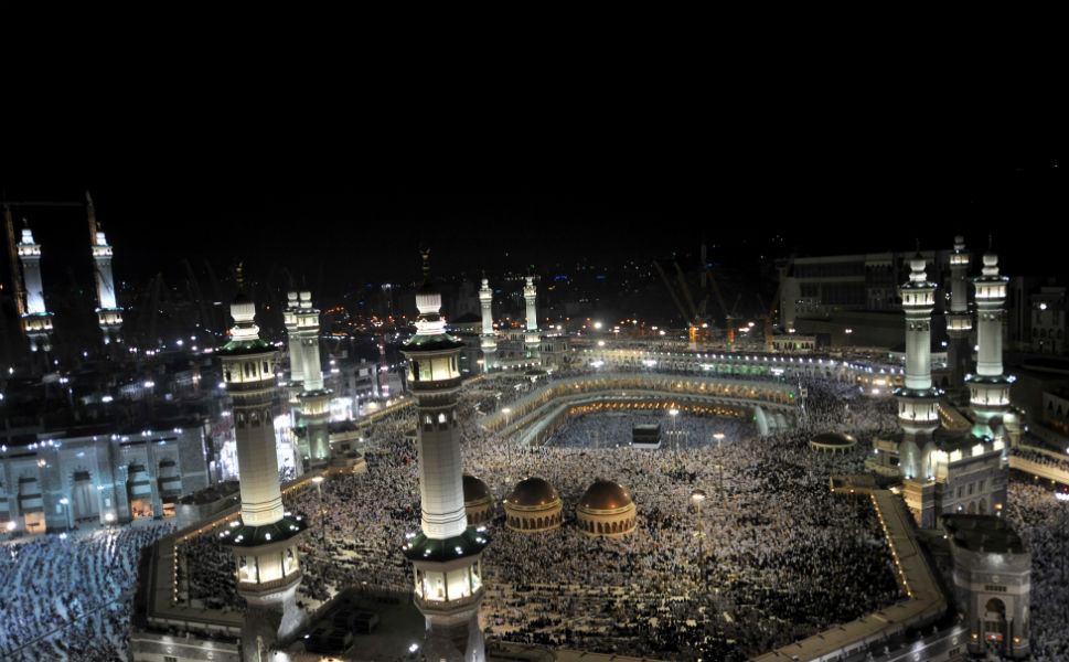 As Mecca  experiences an influx of foreigners, the Saudi Arabian government has insisted that pilgrims will  not be affected by the instability in Syria or recent outbreaks in violence in Lebanon. Above, pilgrims gather at night in the Grand Mosque on  Oct. 22.