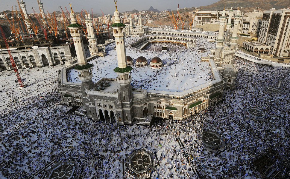 Every year, millions of pilgrims come  from around the world to pay homage at the Muslim holy city of Mecca in Saudi Arabia, which is believed to be the birthplace of the Prophet Muhammad. Every  able-bodied Muslim is expected to make the trip at some point in the lives, and  those who have taken the hajj, as the pilgrimage is known, can add the honorific hajji  to their names. Here, we take a look at Mecca as this year's hajj, which officially begins Wednesday, kicks off.       The hajj begins at a way station just  outside Mecca known as the Miqat, where visitors put on ceremonial seamless garments and recite  a prayer. The pilgrims then walk to the Kaaba -- the most sacred site in Islam -- and walk around it seven times  repeating prayers. Above, an aerial view shows Muslim pilgrims gathering at the  Grand Mosque in Mecca on Oct. 22.The Kaaba is the square, black building inside the mosque.
