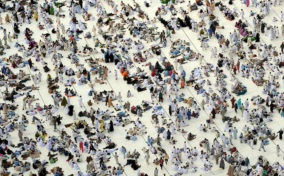 While on the hajj, male pilgrims are  expected to wear the ihram, a seamless, white tunic, and women to wear a hijab, or head scarf. As a  pilgrim, participants are not allowed  to shave, clip their nails, have sex, argue, kill animals, or carry weapons. Above,  people wait for the start of prayers in the Grand Mosque on Oct. 22.
