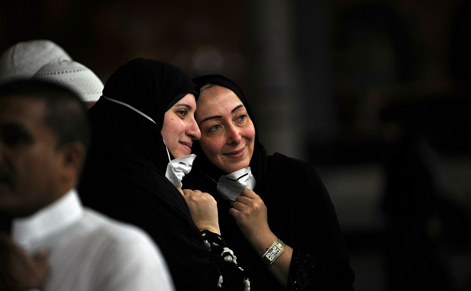 Muslim pilgrim women pose for picture after the end of   evening prayers at the Grand Mosque in Mecca, on   Oct. 23.