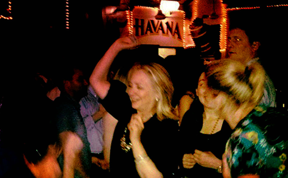 But sometimes the former first lady lets her wild child out. In this now infamous photo, Clinton enjoys a relaxed moment at Cafe   Havana in Cartagena, Colombia, on April 15, 2012. Clinton was in Cartagena  to attend the sixth Summit of the Americas.