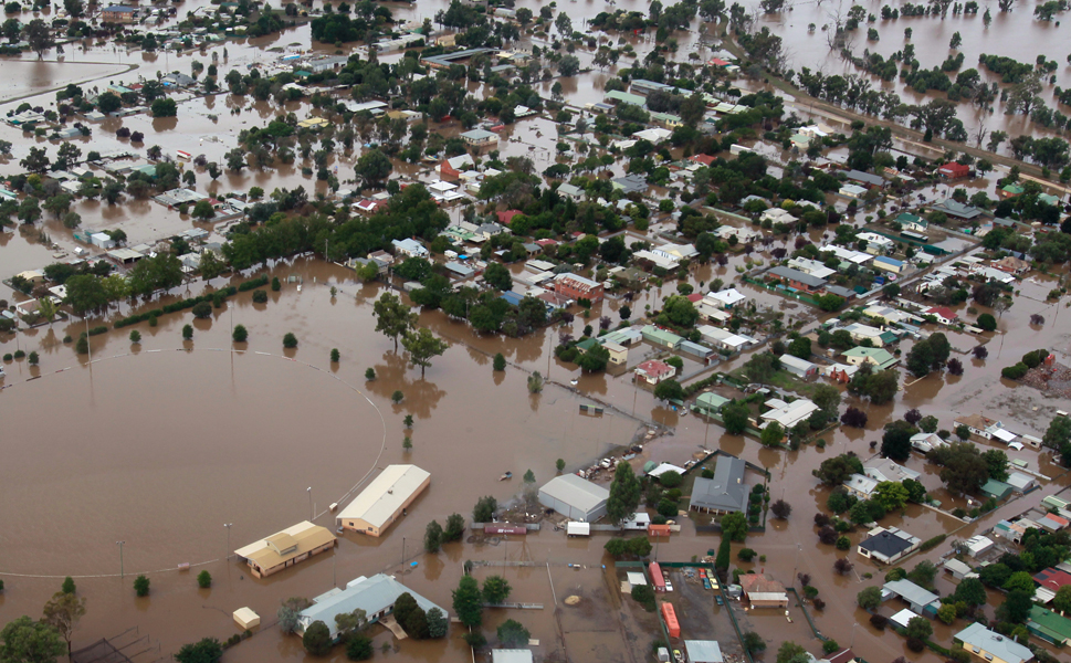 An aerial  view shows flooding in North Wagga Wagga during a helicopter tour by Australian  Prime Minister Julia Gillard as she reviewed the disaster zone on March 7. Thousands of people fled their homes and at least two died after 12 inches of rain fell in just 24 hours.