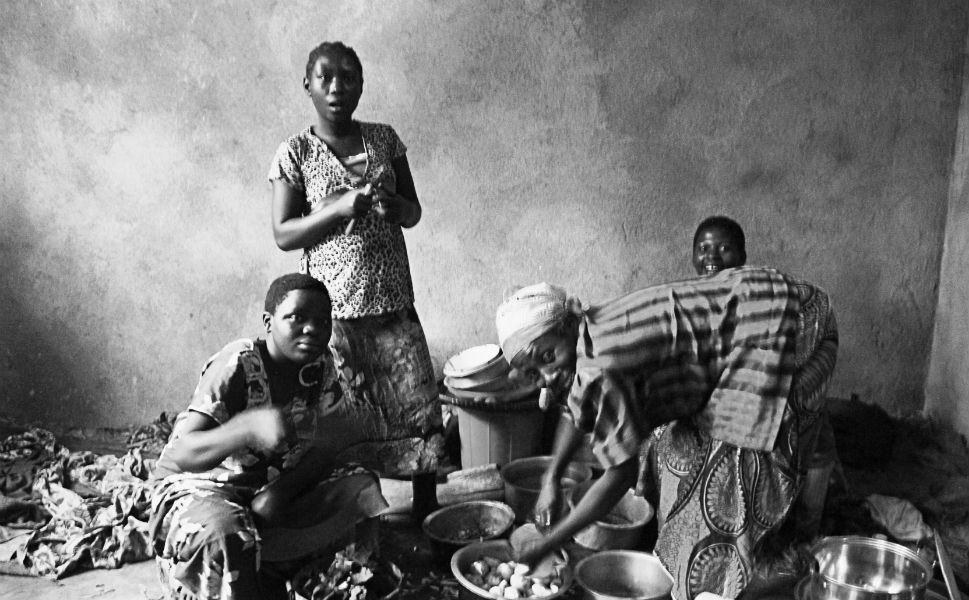 A grandmother and her granddaughters prepare dinner in an abandoned building in South Kivu that now houses hundreds of displaced families.