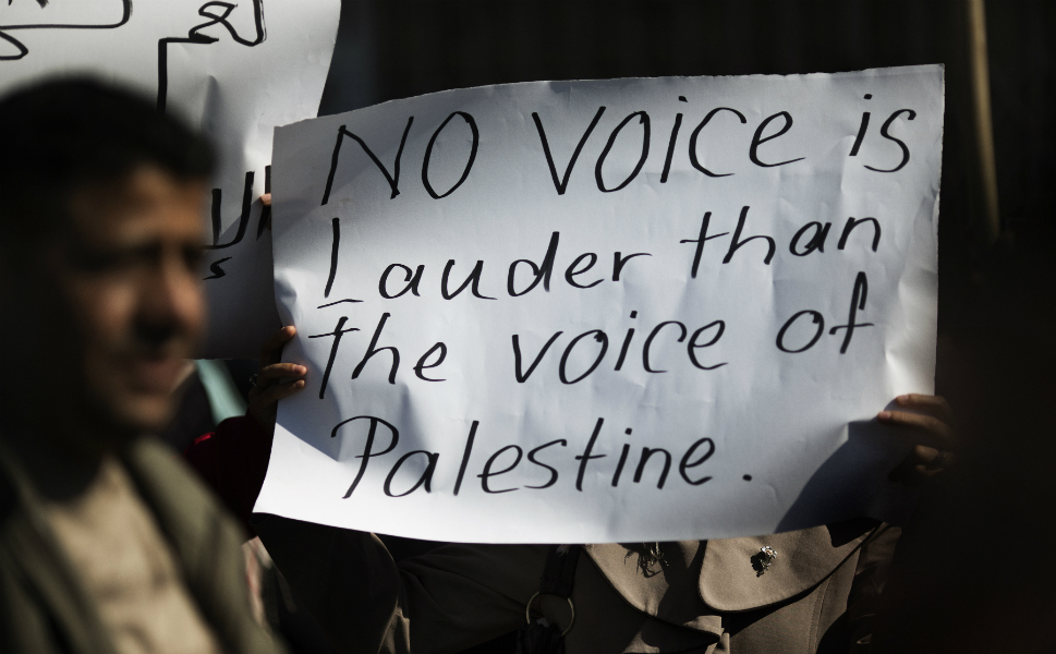 Palestinians gather for a demonstration calling for the end  of the political division between the Gaza Strip's Hamas-led leadership and the  Palestinian Authority's Fatah-led movement in Gaza City on Nov. 13.