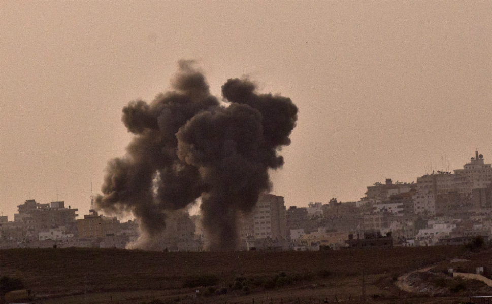A picture taken from the southern Israeli-Gaza border shows  smoke billowing from the Gaza Strip after it was targeted by an Israeli air  strike on Nov. 16, the third day of an intensive campaign which the Israeli military  has said is aimed at stamping out rocket fire targeting southern Israel.