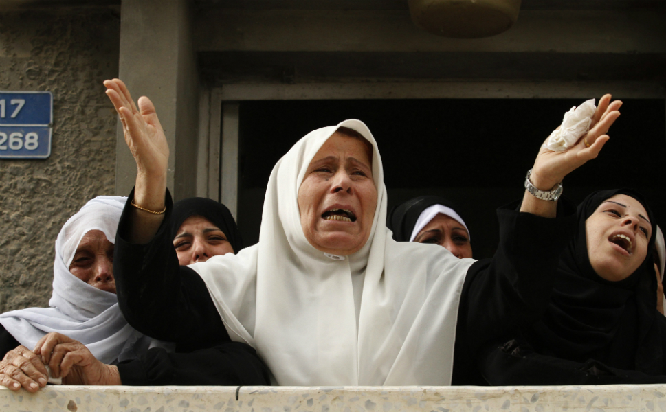 Palestinian relatives of Ahmad Dardasawy, 18, mourn during  his funeral in Gaza City on Nov. 11, after he was killed the day before in  Israeli shelling as clashes erupted along the Israeli-Gaza border.