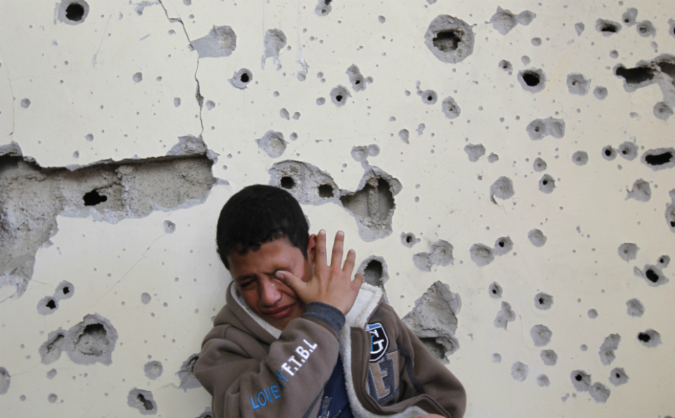 """Egypt's premier vowed to intensify Cairo's efforts to secure  a truce and urged world leaders to end Israel's """"aggression"""" in Gaza during a visit  to the Hamas-run enclave. In this photo, Fares Sadallah, an 11-year-old  Palestinian boy, cries as he sits outside his home, which was damaged in an  Israeli air strike on Beit Lahia in the northern Gaza Strip on Nov. 16."""