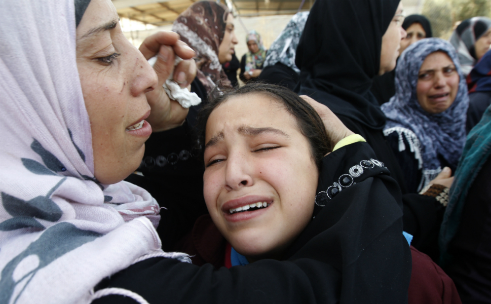 Palestinian women and children mourn during the funeral of  Audi Naser, who was killed in an Israeli air strike on the northern Gaza Strip on  Nov. 16.