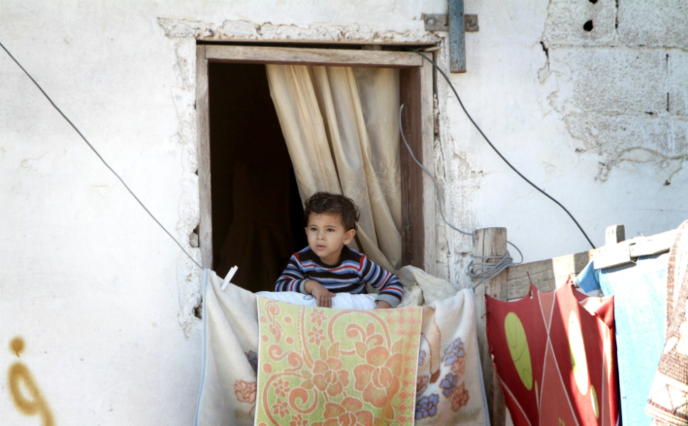 A Palestinian boy watches the funeral of Hisham Ghalban in  the southern Gaza Strip on Nov. 15.