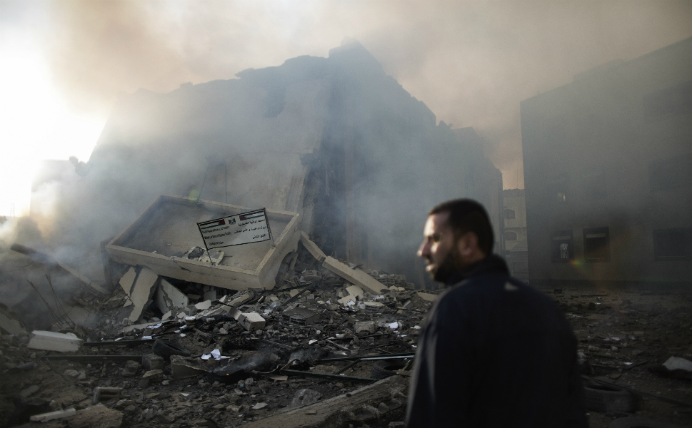 A Palestinian man looks at rubble of the Civilian Affairs  branch of the Ministry of Interior following an Israeli air raid in Gaza City  on Nov.16.