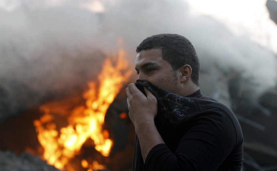 Israeli air strikes killed 31 Palestinians on   Sunday in the bloodiest day of its air   campaign on the Gaza Strip so far, as diplomatic efforts to broker a truce   intensified. In this photo, a Palestinian man covers his face to protect it from smoke as he passes a fire that broke out after Israel struck targets in Gaza City on Nov. 19.