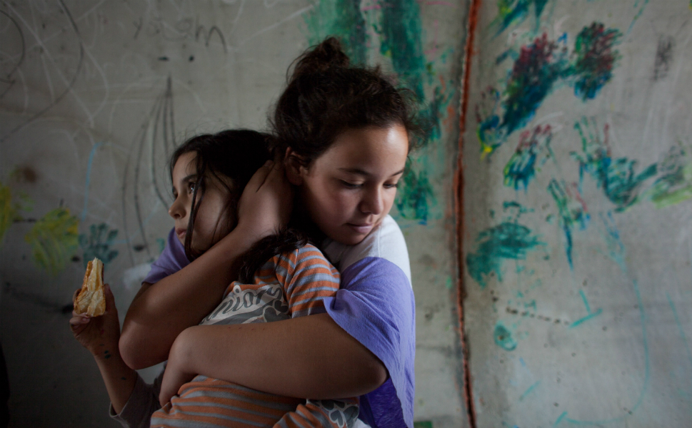 An Israeli girl holds her sister as they take cover in a large concrete   pipe used as a bomb shelter during a rocket attack from the Gaza Strip   on Nov. 19 in Nitzan, Israel.