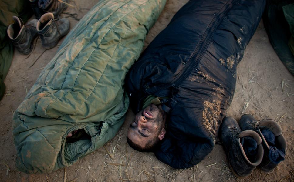 Israeli soldiers sleep in a deployment area near  Israel's border with the Gaza Strip on Nov.19.