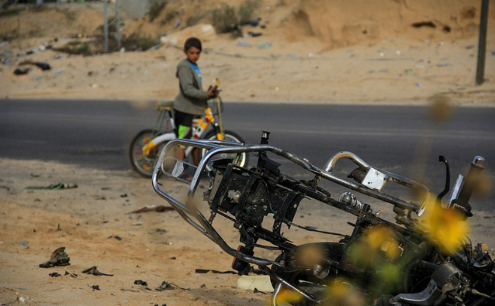 This is  the motorcycle that the fighter was on when he was targeted. The bike was lying  there, and a kid was just watching the scene around us. It was strange: everything  except the body was there. His shoes, some clothes, even the remnants of a  Pepsi can -- maybe he was drinking it at the time of the attack.