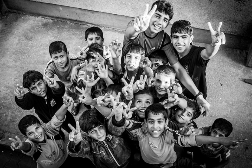 Children  pose for the camera in Gaza City.