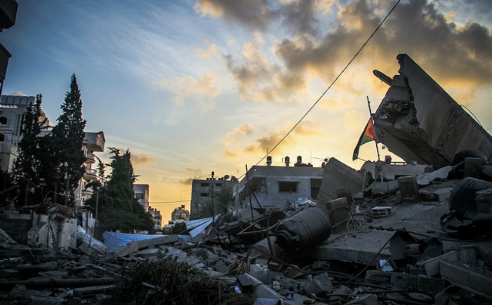 Buildings  lay in rubble as dusk settles on the Gaza Strip.