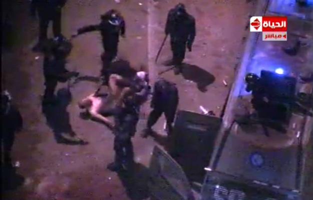 614321_naked_beaten_protestor_edited_2.jpg