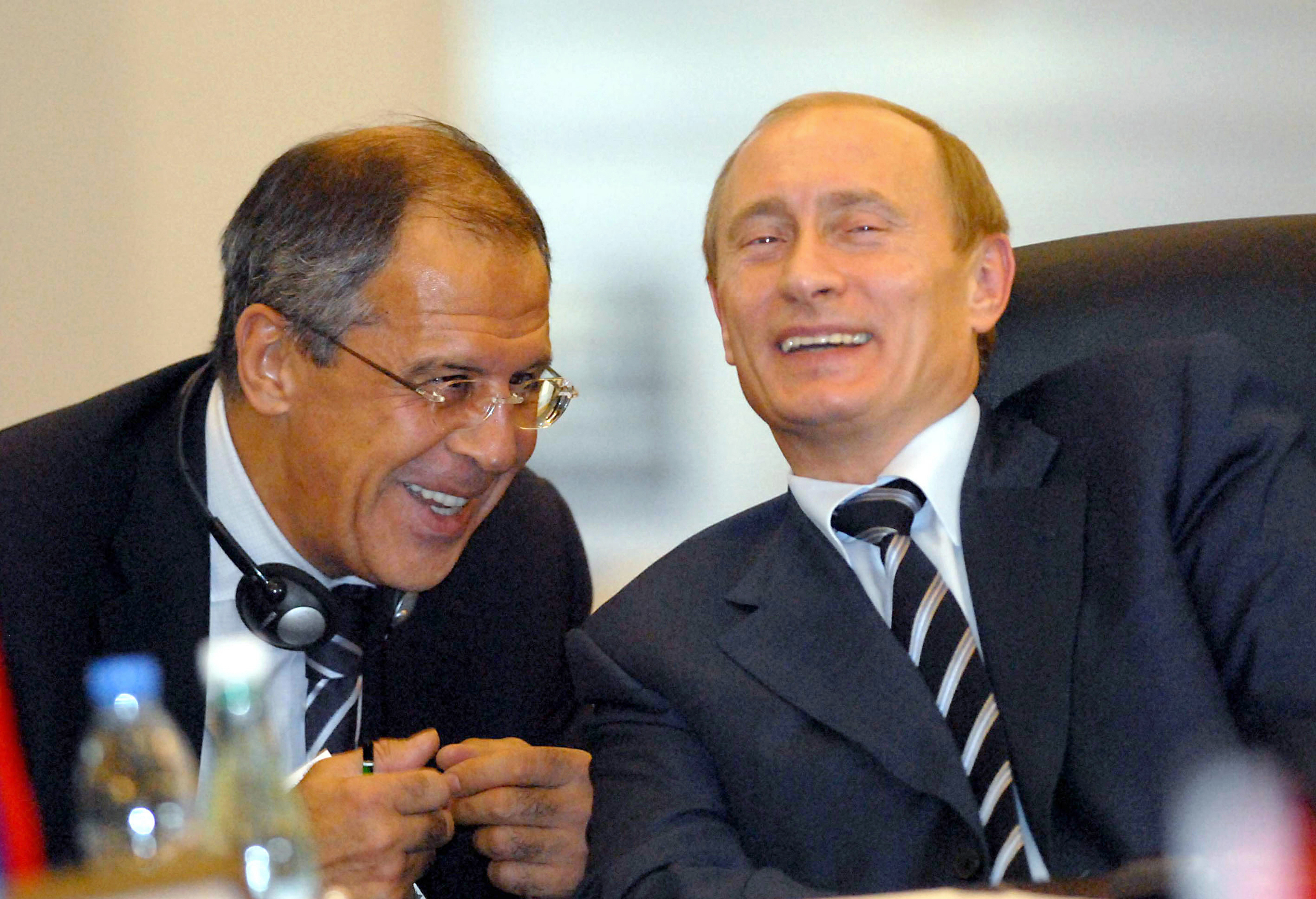 Russian President Vladimir Putin (R) shares a joke with Russia's Foreign Minister Sergei Lavrov during the Organization of the Black Sea Economic Cooperation (BSEC) summit in Istanbul, 25 June 2007. The leaders of a dozen nations in the Black Sea region, including Russia, gathered in Istanbul, 25 June 2007 under tight security to discuss ways to boost trade and economic cooperation. The summit marks the 15th anniversary of the BSEC, which promotes stability and economic ties between nations that belonged to opposite camps during the Cold War. AFP PHOTO/ANATOLIAN NEWS AGENCY/POOL (Photo credit should read ANATOLIAN NEWS AGENCY/AFP/Getty Images)