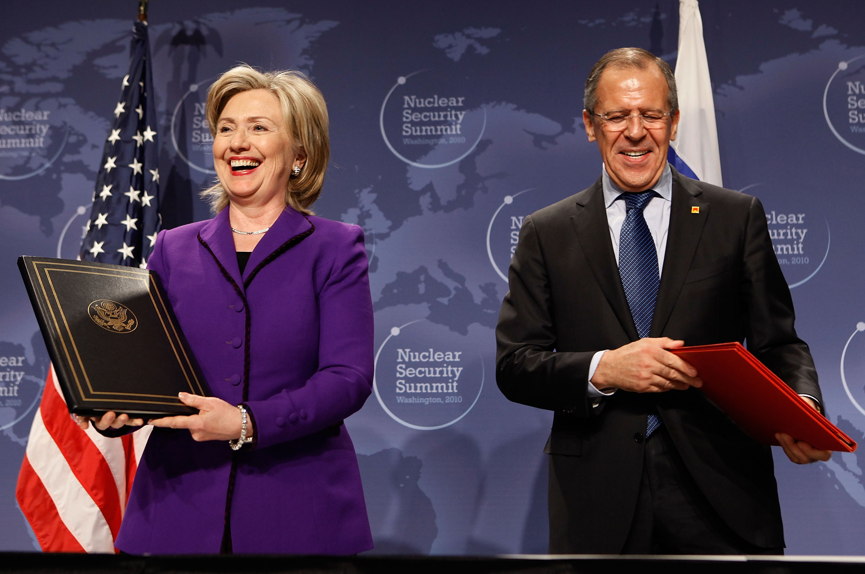 WASHINGTON - APRIL 13: U.S. Secretary of State Hillary Rodham Clinton (L) and Russian Foreign Minister Sergey Lavrov smile after signing an agreement on eliminating excess weapon-grade plutonium from their defense programs during the Nuclear Safety Summit at the Washington Convention Center April 13, 2010 in Washington, DC. Clinton said the irreversable process of desposing of each countries excess weapon-grade plutonium, enough material for several thousand nuclear weapons, will prevent it from falling into the hands of terrorists. (Photo by Chip Somodevilla/Getty Images)