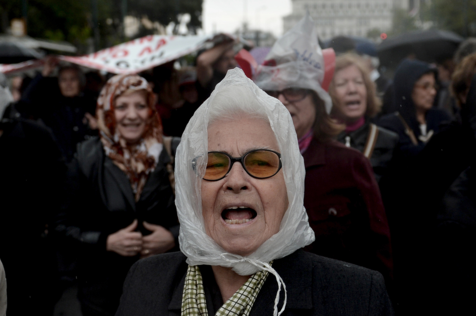 A pensioner shouts a slogan in central Athens during an  anti-austerity demonstration on April 19, 2013.       ARIS MESSINIS/AFP/Getty Images