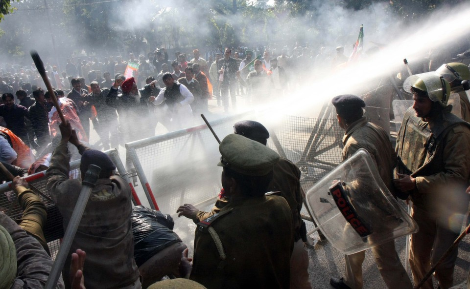 Police using  water canons on Bharatiya Janata Party workers protesting against minister Sushilkumar  Shinde's Hindu terror remark on Jan. 24, 2013 in Chandigarh, India. Home Minister Shinde has alleged that the Bharatiya Janata Party and the Rashtriya Swayamsevak Sangh Party were behind Hindu terror during a Congress Conclave at Jaipur.      Keshav Singh/Hindustan Times/ Getty Images