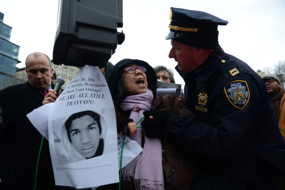 A police officer stops demonstrators from using a loudspeaker as  they take part in a protest in New York on Feb. 26, 2013, to mark the  one-year anniversary of the fatal shooting of Florida teenager Trayvon Martin  by George Zimmerman.       EMMANUEL DUNAND/AFP/Getty Images